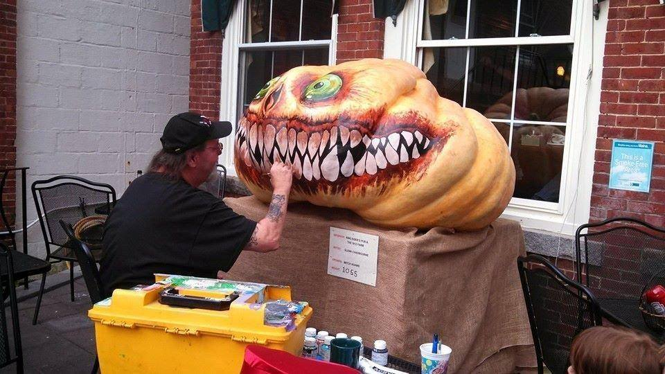 Glenn Chadbourne painting a pumpkin