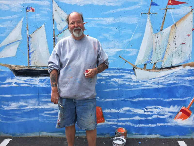 Glenn Chadbourne, famous for illustrating Stephen King books, was in Boothbay Harbor on June 9 doing some not-so-spooky touch-ups on a mural. SUZI THAYER/Boothbay Register